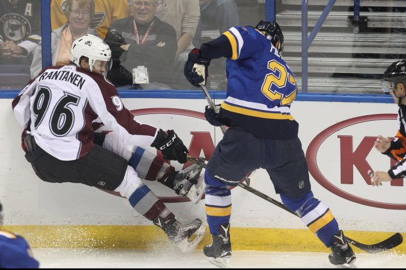 St. Louis Blues' Alex Pietrangelo pushes Colorado Avalanche's Mikko Rantanen of Finland. Photo by Bill Greenblatt/UPI