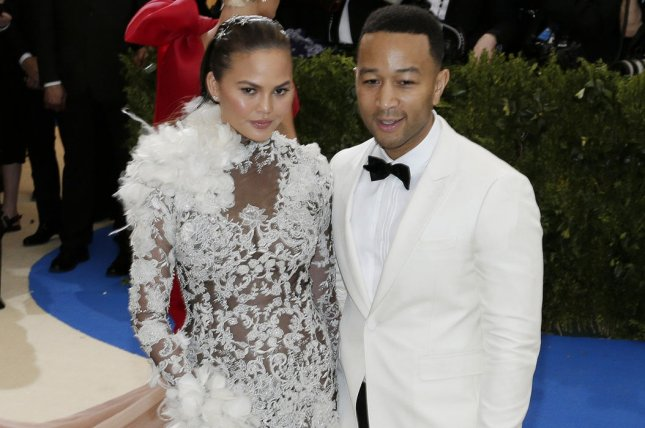 Chrissy Teigen (L) and John Legend attend the Costume Institute Benefit at the Metropolitan Museum of Art on May 1. The model missed Legend's performance at the 2017 Billboard Music Awards because she was seeing Magic Mike Live. File Photo by John Angelillo/UPI