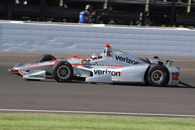 Will Power exits the third turn during Pole Day Shoot Out qualifications at the Indianapolis Motor Speedway in May. Photo by Bill Coons/UPI