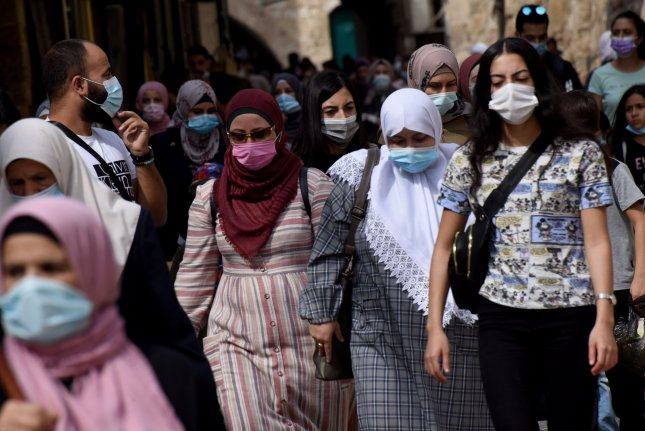 Pedestrians, wearing masks to curb the spread of COVID-19, walk toward the Al Aqsa Compound in the Israeli-controlled Old City of Jerusalem on Thursday. Photo by Debbie Hill/UPI