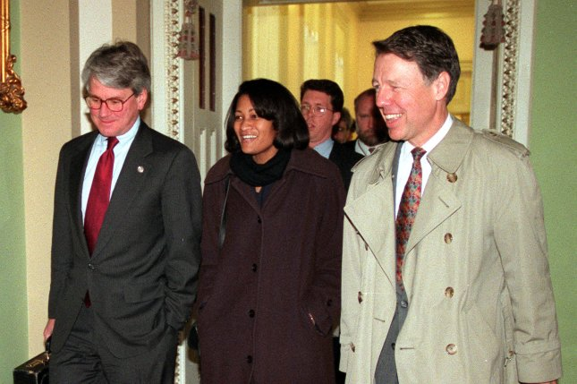 White House Counsel (from left) Gregory Craig, Cheryl Mills and David Kendall arrive at the Capitol, February 8, 1999, for the start of closing arguments in the Impeachment trial of President Bill Clinton. File photo by Ian Wagreich/UPI