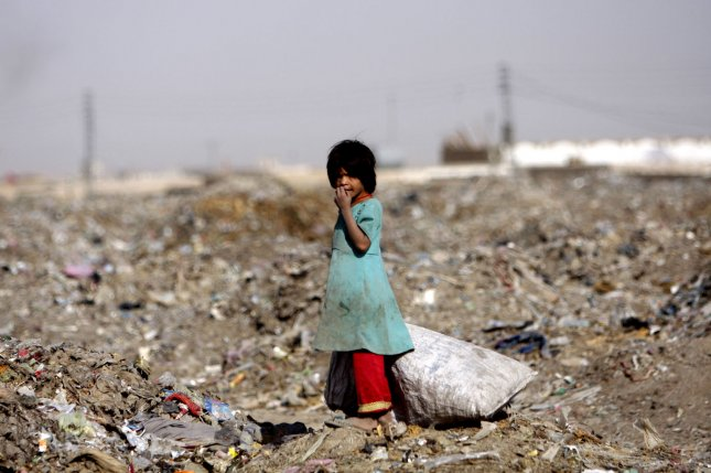 In this photo taken on August 30, 2013, 7 year old Bibi Shagufa collects scraps of paper and plastic at the local garbage dump, in the Pakistani town of Chaman which shares a border with Afghanistan. Chaman is in the Balochistan part of Pakistan and is the crossing point for U.S. vehicles and supplies leaving Afghanistan to Karachi. Poverty levels are increasing As NATO Troops leave Afghanistan and the Afghan youth resort to waiting for the garbage trucks to arrive with a fresh load of trash in the hopes of finding something useable to take home to their families. Mostly they look for things they can burn as fuel for cooking. UPI/Matiullah.