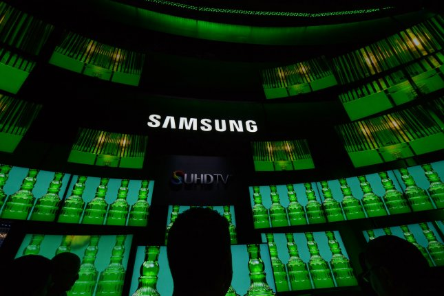 Samsung's new SUHD TVs are displayed at the 2015 International CES, a trade show of consumer electronics, in Las Vegas, Nevada. Samsung's top executive took home $13.2 million in pay even as his division's profits fell by 74 percent. Photo by Molly Riley/UPI