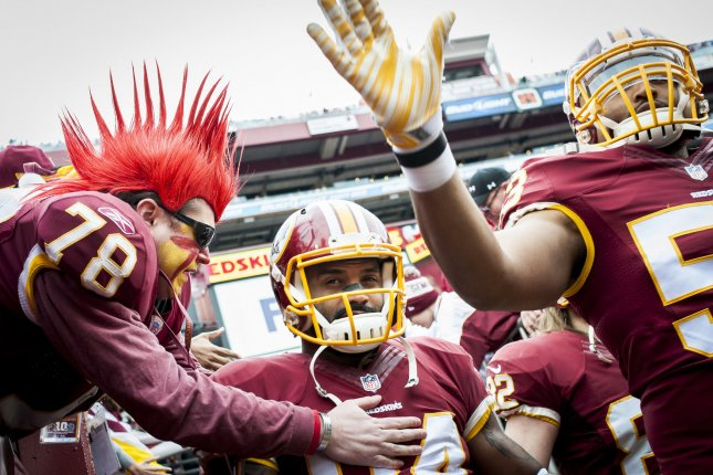 A Washington Redskins fan greets tight end, Niles Paul, before a game against the Dallas Cowboys at FedEx Field in Landover, Maryland on December 28, 2014. UPI/Pete Marovich