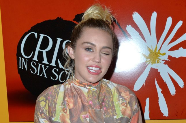 Miley Cyrus poses at The Crisis in Six Scenes premiere at The Crosby Street Hotel in New York City on September 15, 2016. Cyrus joined Billy Idol onstage recently for a suprise performance of Rebel Yell. Photo by Andrea Hanks/UPI