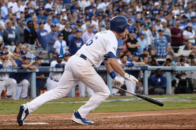 Los Angeles Dodgers' Chase Utley (26) singles for an RBI and the 6-5 lead over the Washington Nationals during the eighth inning of National League Division Series Game 4 at Dodger Stadium in Los Angeles, October 11, 2016. Photo by Jim Ruymen/UPI