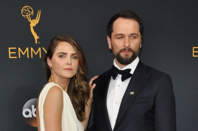 Keri Russell (L) and Matthew Rhys attend the Primetime Emmy Awards on September 18, 2016. The couple appeared Thursday on Watch What Happens Live. File Photo by Christine Chew/UPI