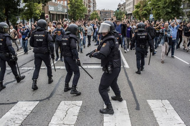 Spanish police clash with demonstrators in Barcelona during an October 1 referendum on Catatonian independence. Photo by Angel Garcia/ UPI