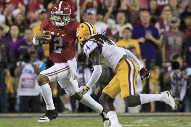 Alabama Crimson Tide quarterback Jalen Hurts (2) picks up five yards before LSU Tigers defensive back Donte Jackson (1) can tackle him in the first quarter on November 5, 2016 at Tiger Stadium in Baton Rouge, Louisiana. File photo by AJ Sisco/UPI
