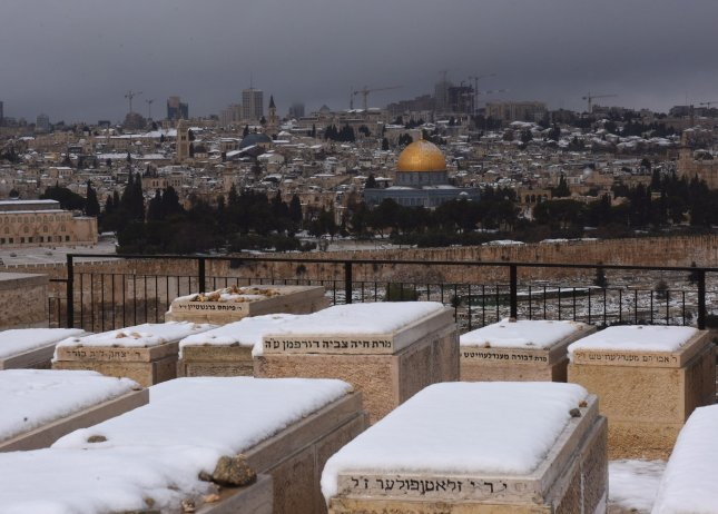 Snow covers the Jewish cemetery on the Mt. of Olives with a view of the Dome of the Rock in the Al Aqsa Mosque Compound in the Old City of Jerusalem, on Thursday. Photo by Debbie Hill/UPI