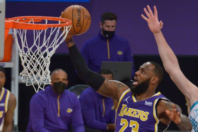 Los Angeles Lakers forward LeBron James scores two of his 37 points during a win over the Charlotte Hornets on Thursday in Los Angeles. Photo by Jim Ruymen/UPI