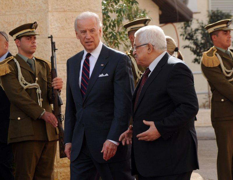 US Vice President Joe Biden and Palestinian President Mahmoud Abbas walk past a honor guard in the Palestinian presidential compound in Ramallah, West Bank, March 10, 2010. UPI/Debbie Hill