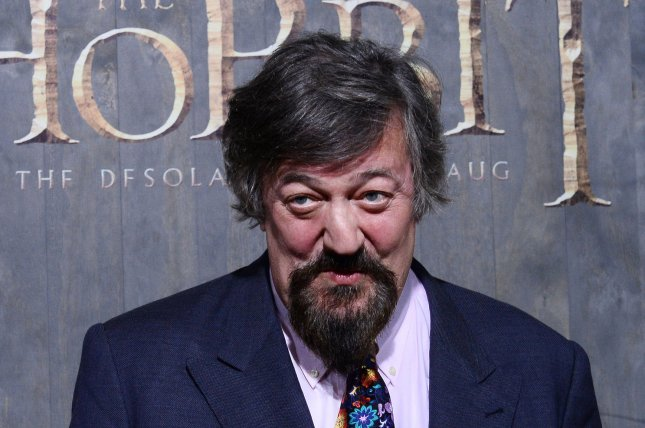 Cast member Stephen Fry attends the premiere of The Hobbit: The Desolation of Smaug at TCL Chinese Theatre in the Hollywood section of Los Angeles on December 2, 2013. Storyline: After successfully crossing over (and under) the Misty Mountains, Thorin and Company must seek aid from a powerful stranger before taking on the dangers of Mirkwood Forest--without their Wizard. If they reach the human settlement of Lake-town it will be time for the hobbit Bilbo Baggins to fulfill his contract with the dwarves. The party must complete the journey to Lonely Mountain and burglar Baggins must seek out the Secret Door that will give them access to the hoard of the dragon Smaug. And, where has Gandalf got off to? And what is his secret business to the south? UPI/Jim Ruymen