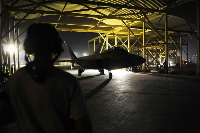 An F-22A Raptor taxis in the U.S. Central Command area of responsibility prior to strike operations in Syria on Sept.r 23, 2014. These aircraft are part of a large coalition strike package that was the first to strike ISIL targets in Syria. UPI/Russ Scalf/USAF