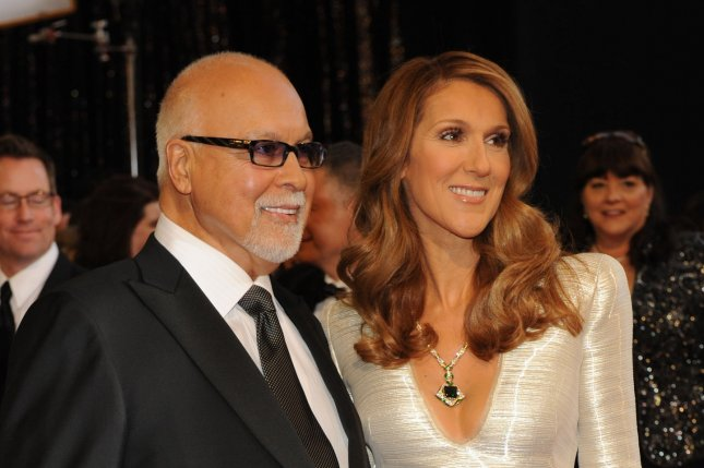 Celine Dion and Rene Angelil at the Academy Awards in 2011. The singer honored her late husband at a memorial ceremony Wednesday. File Photo by Jim Ruymen/UPI