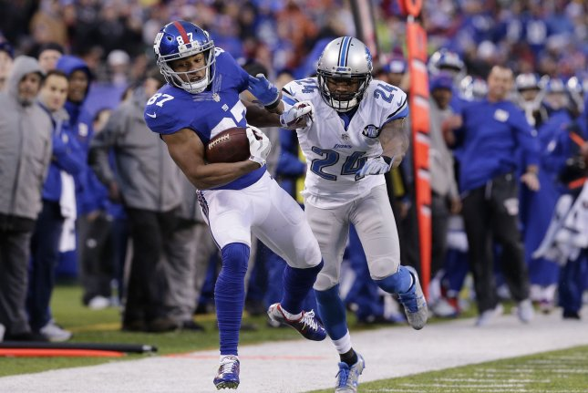Detroit Lions Nevin Lawson chases New York Giants Sterling Shepard who runs for a gain of 23 yards in week 15 of the NFL at MetLife Stadium in East Rutherford, New Jersey on December 18, 2016. The Giants defeated the Lions 17-6. Photo by John Angelillo/UPI