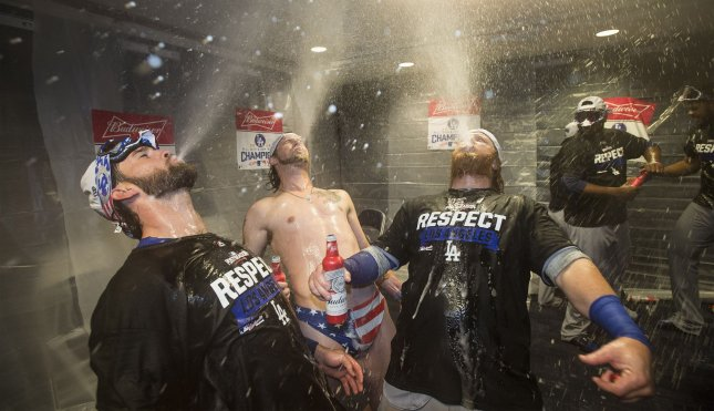 Los Angeles Dodgers Josh Reddick (C) and teammates celebrate their win in the locker room after game 5 of the National League Division Series at Nationals Park on Oct. 13. Kevin Dietsch/UPI