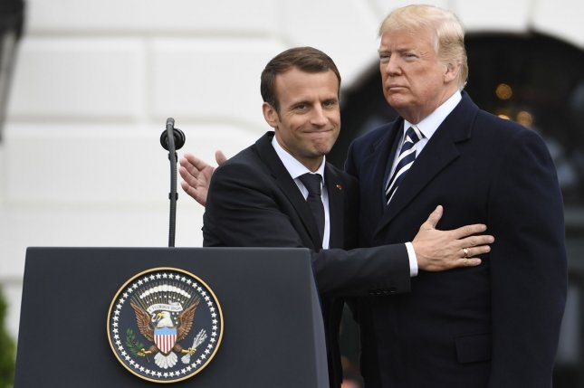 President Donald Trump (R) and French President Emmanuel Macron embrace at the White House on April 24. The two leaders have different visions of the future in the Middle East. Photo by Mike Theiler/UPI