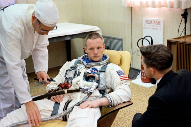 NASA astronaut Neil Armstrong, command pilot of the Gemini 8 spaceflight, sits in the Launch Complex 16 trailer during suiting up operations for the Gemini 8 mission on March 16, 1966. Armstrong became the first person to step foot on the moon in 1969. File Photo UPI