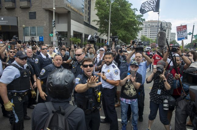 More than 200 supporters of President Donald Trump from Proud Boys, an alt-right group, and a larger number of counterprotesters confronted each other Saturday at the Freedom Plaza. Photo by Tasos Katopodis/UPI