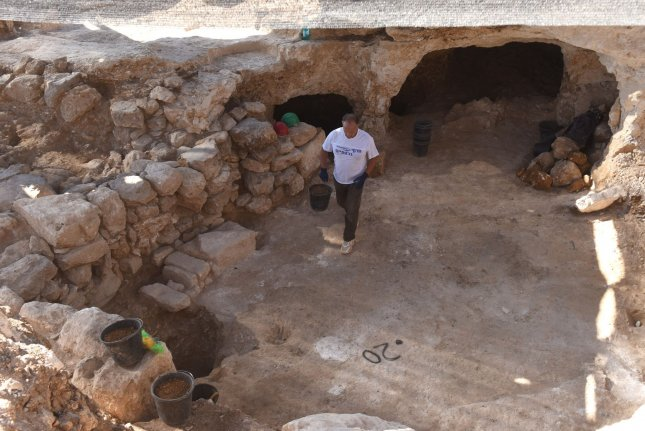 A worker of the Israel Antiquities Authority cleans excavations Wednesday at a significant storage center -- from the days of Kings Hezekiah and Menashe -- that was uncovered near the U.S. Embassy in Jerusalem, Israel. Photo by Debbie Hill/UPI