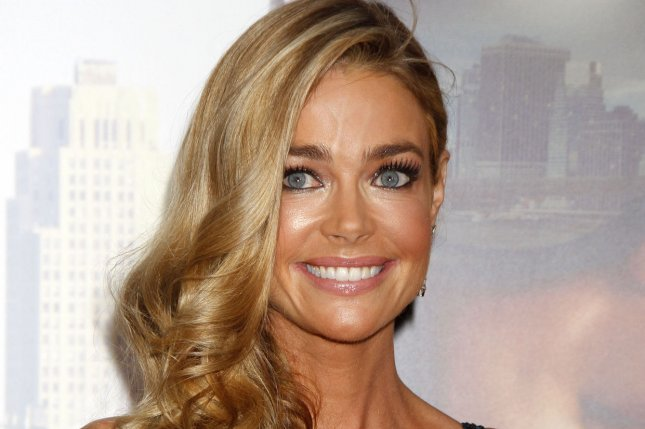 Denise Richards will exit Real Housewives of Beverly Hills following drama over her alleged affair with Brandi Glanville. File Photo by Laura Cavanaugh/UPI