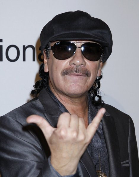 Carlos Santana arrives on the red carpet before the annual Clive Davis Pre-Grammy Gala in Beverly Hills, California on January 30, 2010. (UPI/David Silpa)