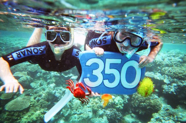Two children hold a 350 sign underwater at the Great Barrier Reef on the International Day of Climate Action in Australia on October 24, 2009. The number 350 represents what scientists say is the safe upper limit for carbon dioxide in the Earth's atmosphere. UPI/350.org
