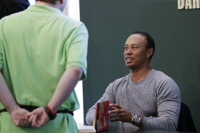 Tiger Woods signs a copy of his book, The 1997 Masters: My Story, on March 20 at the Union Square Barnes & Noble in New York City. File photo by John Angelillo/UPI