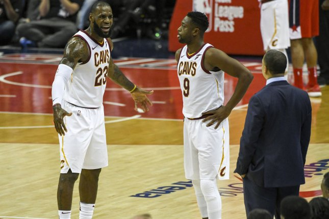 Cleveland Cavaliers forward LeBron James (23) has words with head coach Tyronn Lue as guard Dwyane Wade (9) looks on in the first half on November 3 at Capital One Arena in Washington, D.C. Photo by Mark Goldman/UPI