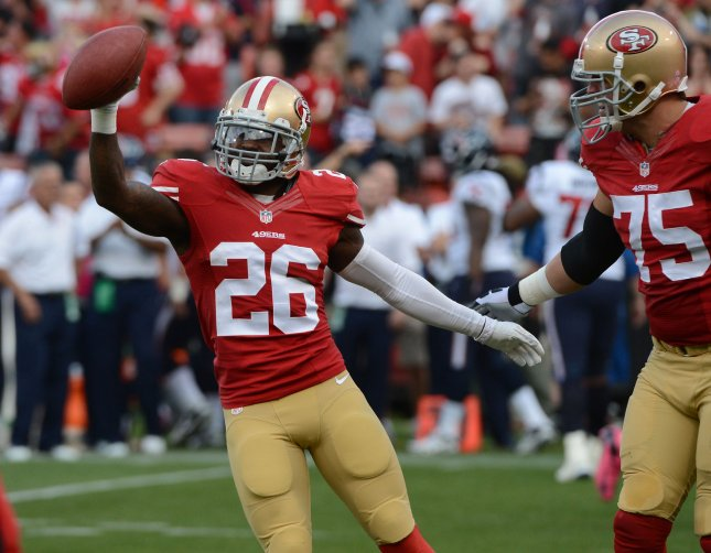San Francisco 49ers defensive back Tramaine Brock (26) celebrates an interception return during a game against the Houston Texans in 2013. File photo by Terry Schmitt/UPI