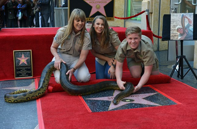 The late animal activist Steve Irwin's wife Terri Irwin (L), their daughter Bindi Irwin (C) and son Robert Irwin hold Angelina, a South American green anaconda, at the star unveiling ceremony for Irwin who was posthumously honored with a star on the Hollywood Walk of Fame in Los Angeles on Thursday. Photo by Chris Chew/UPI