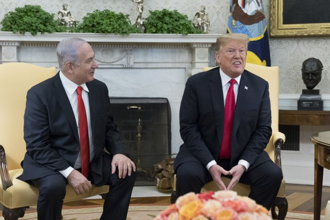 Israeli rime Minister Benjamin Netanyahu (L) speaks beside President Donald J. Trump during their meeting in the Oval Office of the White House on March 25. Trump earlier signed an order recognizing Golan Heights as Israeli territory. Pool Photo by Michael Reynolds/UPI