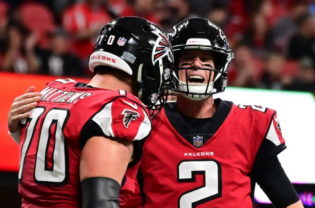 Atlanta Falcons quarterback Matt Ryan (R) became the 10th quarterback in NFL history to reach 50,000 career passing yards. File Photo by David Tulis/UPI