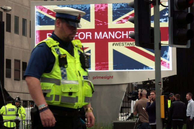 Police patrol near the Manchester Arena in Manchester, Britain, on May 23, 2017, following a suicide bombing attack that killed nearly two dozen people. File Photo by Mushtaq Mohammed/UPI