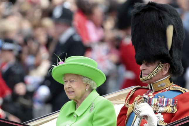 Queen Elizabeth II and Prince Philip travel in an open state carriage during the annual Trooping the Colour to celebrate the Queen's 90th birthday in June 2016. Elizabeth and other members of the Royal Family wished Archie Mountbatten-Windsor a happy birthday. File Photo by Hugo Philpott/UPI