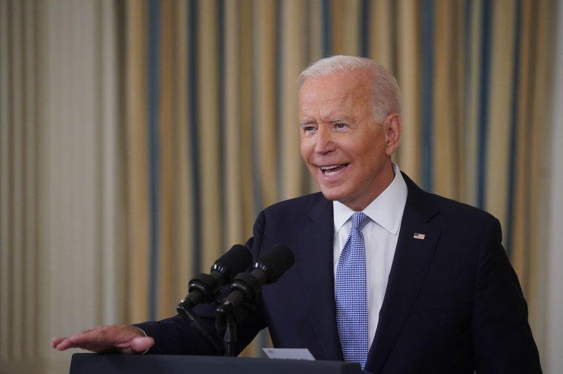 U.S. President Joe Biden speaks in the State Dining Room of the White House on Friday. Photo by Al Drago/UPI