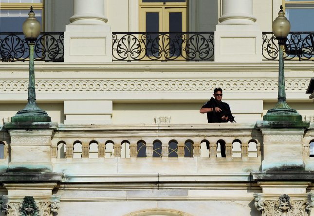 A Capitol Hill Police officer stands guard on the balustrade of the U.S. Capitol building in Washington, DC, on September 10, 2011. Law enforcement officials in Washington, New York and around the world were on heightened alert in the days leading up to the 10th anniversary of the September 11 terrorist attacks. UPI/Roger L. Wollenberg