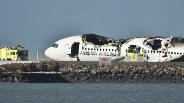 The remains of an Asiana Airlines Boeing 777sits on the runway at San Francisco International Airport after it crashed on landing in San Francisco on July 6, 2013. The plane was arriving from Seoul. UPI/Terry Schmitt