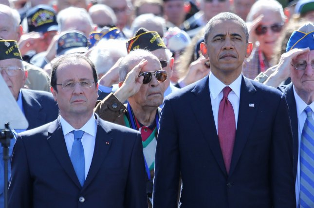 French President Francois Hollande (L) and U.S. President Barack Obama attend a French-American bilateral ceremony commemorating the 70th anniversary of the D-Day landings in the Normandy region of France at the Normandy American Cemetery in Colleville-sur-Mer to on June 6, 2014. UPI/David Silpa
