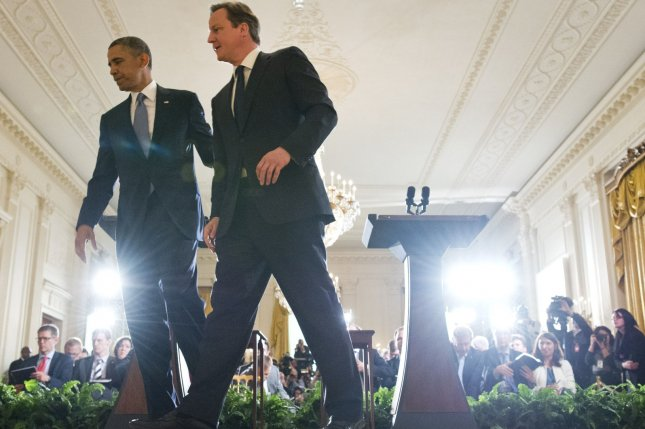 U.S. President Barack Obama (R) and Prime Minister David Cameron of the United Kingdom leave after holding a joint press conference in the Rose Garden at the White House in Washington, D.C. on May 13, 2013..UPI/Kevin Dietsch