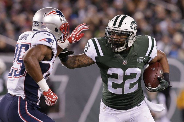 cac9978f022 New England Patriots Eric Rowe tries to bring down New York Jets Matt Forte  who carries the football in the first half against the in week 12 of the  NFL at ...