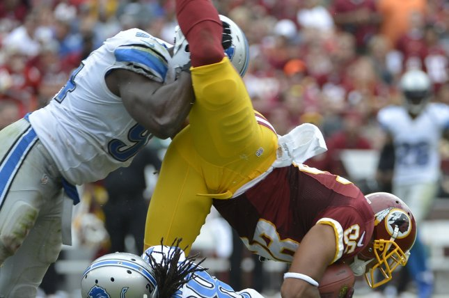 Washington Redskins tight end Jordan Reed (86) is upended by Detroit Lions defenders Bill Bentley (on ground) and Ezekiel Ansah (94) during the second quarter on September 22, 2013 at FedEx Field in Landover, Maryland. File photo by Mike Theiler/UPI