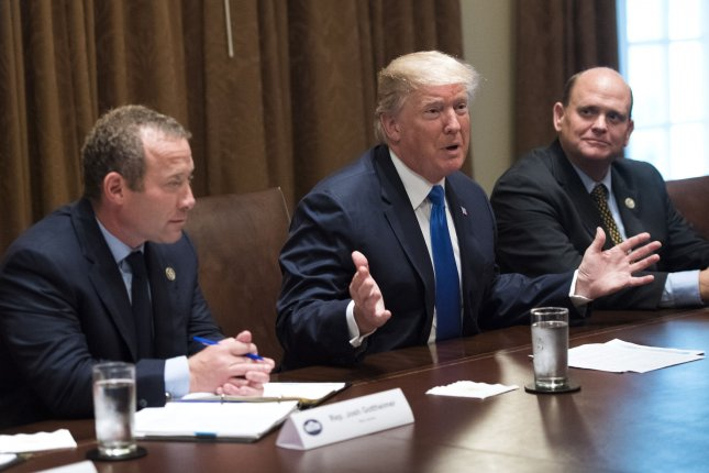 Rep. Josh Gottheimer (L), D-N.J., shown here with Republican President Donald Trump and Rep. Tom Reed (R), R-N.Y., is one of the younger members of the House with a high score for bipartisanship in a recent study. File Photo by Kevin Dietsch/UPI