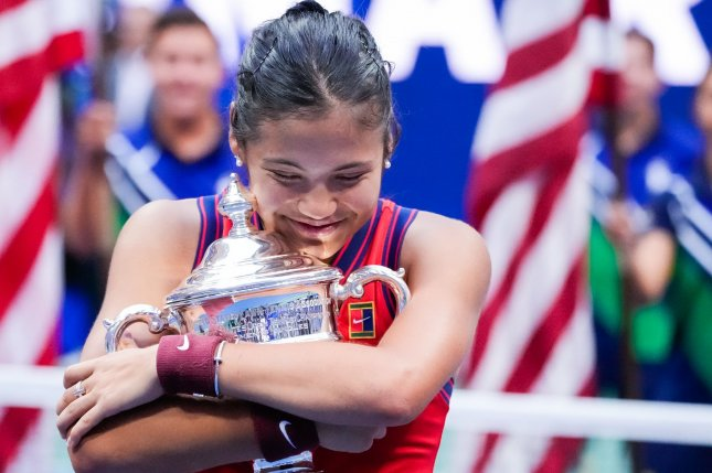 Emma Raducanu of Great Britain hugs the winner's trophy after her victory over Leylah Fernandez of Canada in straight sets in the Women's Final at Arthur Ashe Stadium at the 2021 U.S. Open Tennis Championships on Saturday in Forest Hills, N.Y. Photo by Corey Sipkin/UPI