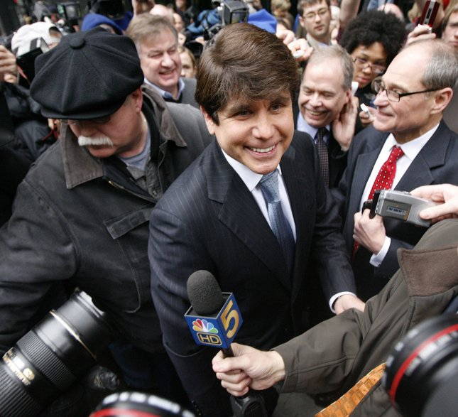 Former Illinois Gov. Rod Blagojevich leaves federal court for his arraignment on 16 criminal counts including racketeering conspiracy and wire fraud in Chicago on April 14, 2009. Blagojevich was originally arrested on December 9, 2009 and impeached by the state legislature and removed from office in January 2009. (UPI Photo/Brian Kersey)