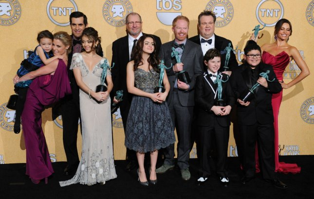 Modern Family cast members appear backstage with the award they garnered for best comedy series during the 18th Annual Screen Actors Guild Awards at the Shrine Auditorium in Los Angeles on January 29, 2012. UPI/Jim Ruymen