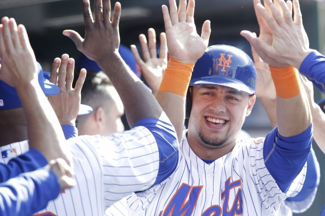 New York Mets' Michael Conforto celebrates after scoring a run in the 1st inning against the San Francisco Giants at Citi Field in New York City on April 30, 2016. Photo by John Angelillo/UPI