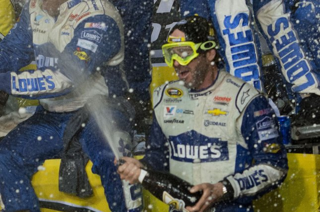 NASCAR Nationwide Series Championship driver Jimmie Johnson celebrates after winning the Ford EcoBoost 400 at Homestead-Miami Speedway in Homestead, Florida on November 20, 2016. Photo By Gary I Rothstein/UPI