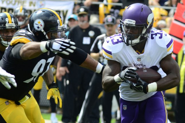 Pittsburgh Steelers defensive end Cameron Heyward (97) stops Minnesota Vikings running back Dalvin Cook (33) for a loss of four yards in the first quarter of the Steelers home opener at Heinz Field on September 17, 2017 in Pittsburgh. File photo by Archie Carpenter/UPI